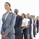 Successful business people lined up in over white background